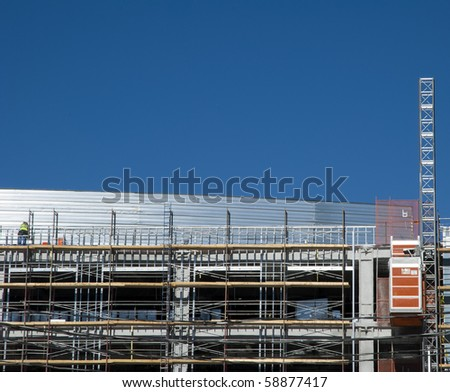 Construction: installing the outer wall - stock photo
