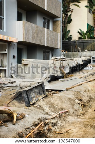 Construction is almost finished for a new apartment building and the sidewalk in front of it.  - stock photo