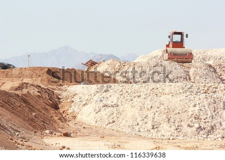 Construction landscape with heap of sand - stock photo