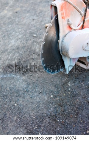 Construction machine used for cutting through concrete or tarmac roads. Focus on blade - stock photo