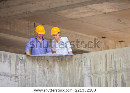 Construction manager and engineer woman working on building site