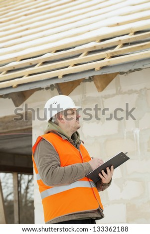 Construction manager checking new building - stock photo