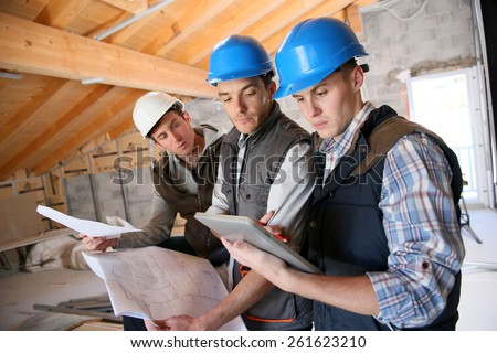 Construction manager with workers checking on site - stock photo