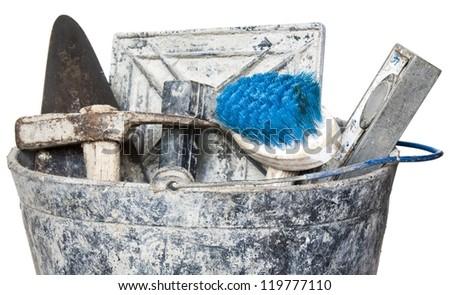 Construction masonry cement mortar tools on bucket,isolated - stock photo