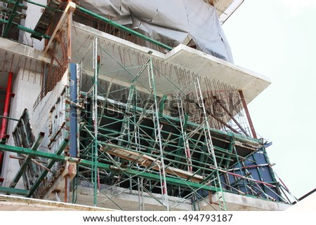 construction metal scaffolding with high building