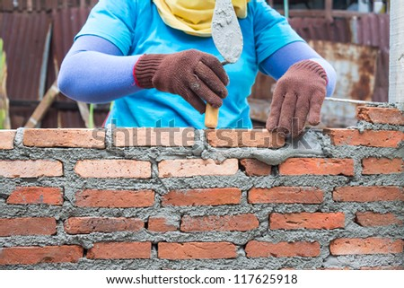 Construction of a brick wall.