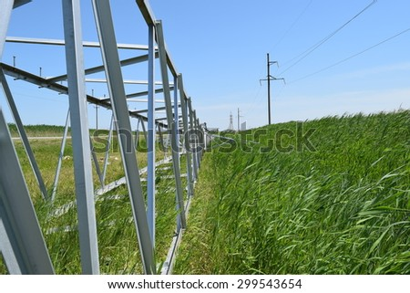 Construction of a high-voltage power line. Stages of installation of mast support and wires.