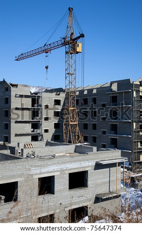 construction of a multistory building. cloudless day