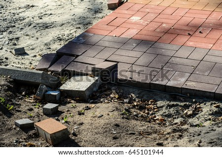 Construction of a new pavement of paving slabs