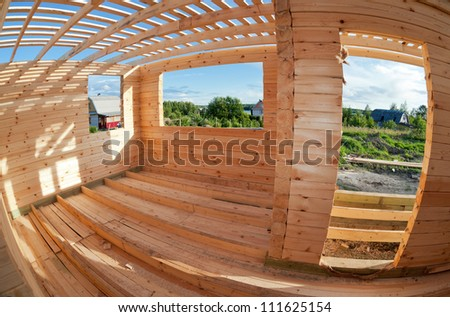 Construction of a new wooden house. - stock photo