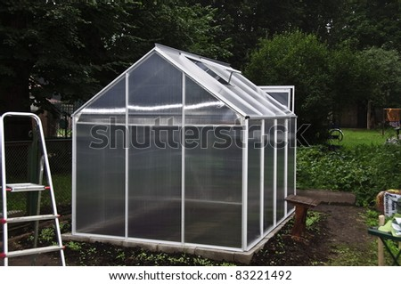 Construction of a small greenhouse - stock photo