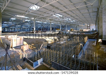 Construction of an industrial building of manufactory - stock photo