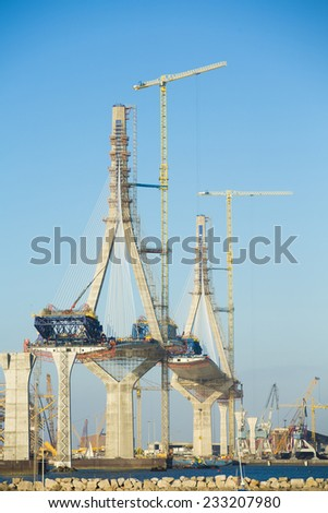 Construction of big guyed bridge in Cadiz over the sea - stock photo