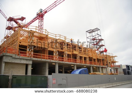 Construction of buildings with construction cranes
