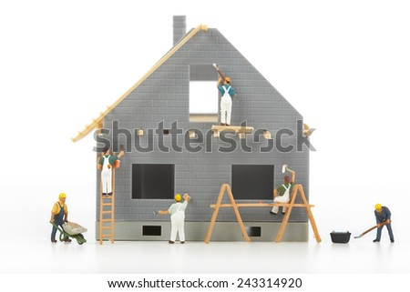 Construction of cottages. Workers at a construction site at home - stock photo