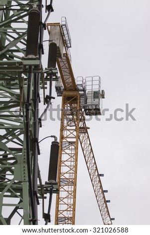 Construction of electric transmission line with yellow crane