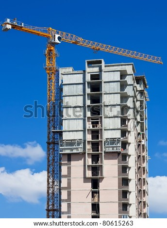 Construction of high-rise apartment building - stock photo