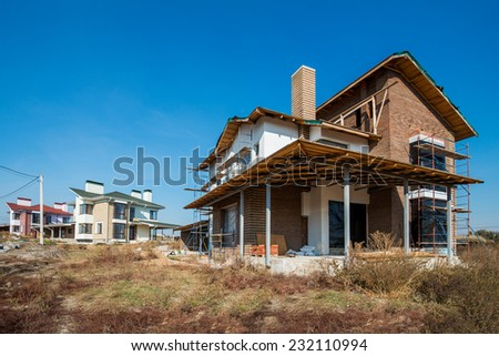 construction of houses and cottage town - stock photo