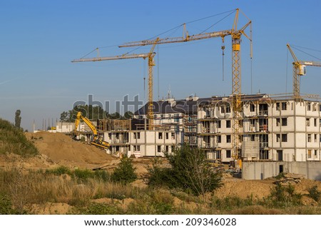 Construction of houses during the sunrise - stock photo