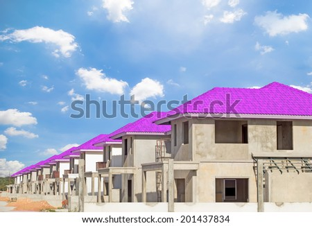 Construction of housing with sky background.