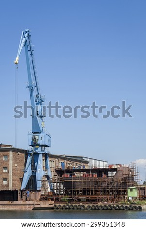 Construction of hull of the ship in a shipyard - stock photo