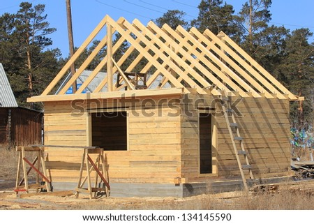 construction of log houses - stock photo