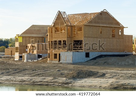 Construction of new houses - stock photo