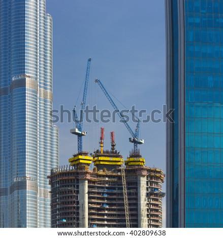 Construction of new modern skyscraper in luxury Dubai city,United Arab Emirates - stock photo