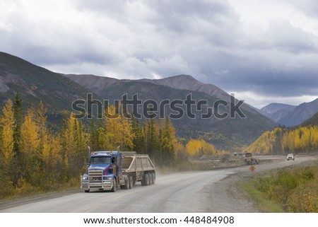 CONSTRUCTION OF NEW SECTION OF FAMOUS ALASKAN HIGHWAY , CANADA: September 20, 2015 - Construction equipment building another part of Alaskan HWY. - stock photo
