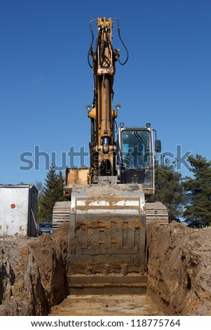 Construction of new street. excavators digging sewer trench - stock photo