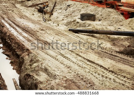 Construction of new tramway tracks in old town of european city. Outdoor shot