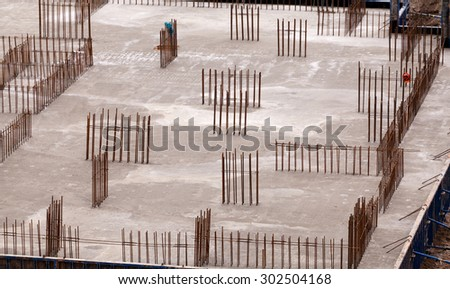 Construction of the building. Construction of an apartment house. Concrete slab foundation building. The foundation of reinforced concrete multistory apartment building.  - stock photo