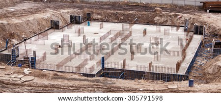 Construction of the building. Construction of an apartment house. Concrete slab foundation building. The foundation of reinforced concrete multistory apartment building.