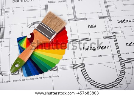 Construction of the building layout, building drawing on paper, paint brush and color samples, selecting paint colors, construction planning.