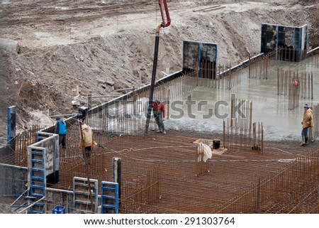 Construction of the building. Pouring the concrete foundation slab foundation. The concrete base slab foundation under the building. Stages of construction of the building. Foundation plate and - stock photo