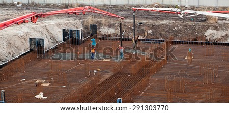 Construction of the building. Pouring the concrete foundation slab foundation. The concrete base slab foundation under the building. Stages of construction of the building. Foundation plate and