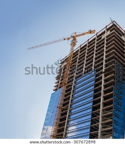 Construction of the new building is completely made of glass - stock photo