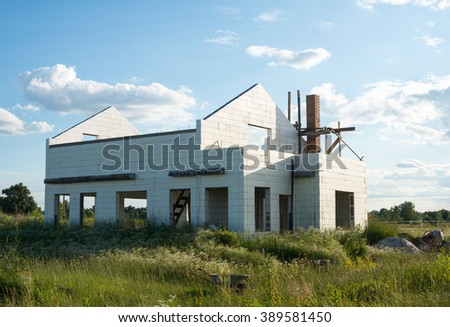 Construction of the new white brick house. - stock photo