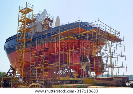 Construction of the ship in shipyard - stock photo