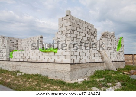 Construction of the Unfinished white brick house - stock photo