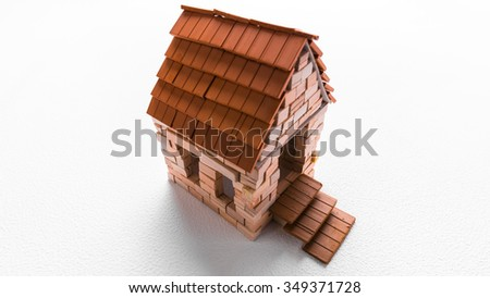 Construction of toy brick house is finished. White background. A top perspective view. - stock photo