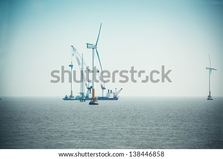 construction of wind power in shanghai offshore wind farm - stock photo