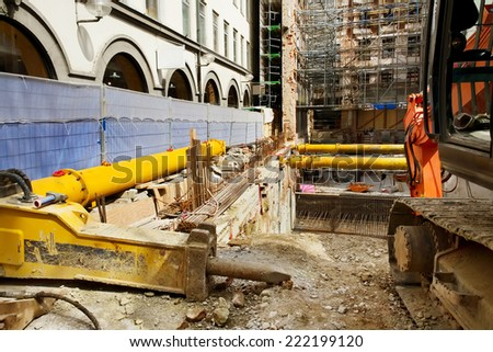 Construction pit. Reconstruction of old building with scaffolding undergoing repair-, Munich, Germany - stock photo