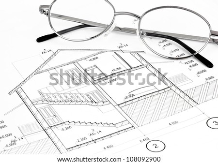 construction plan with eyeglasses - stock photo