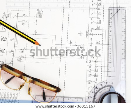 construction plan with pencil, glasses and ruler on it - stock photo