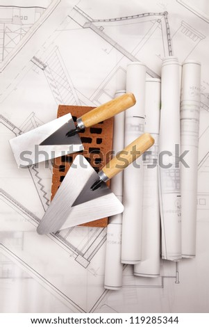 Construction plans and blueprints, bricks - stock photo