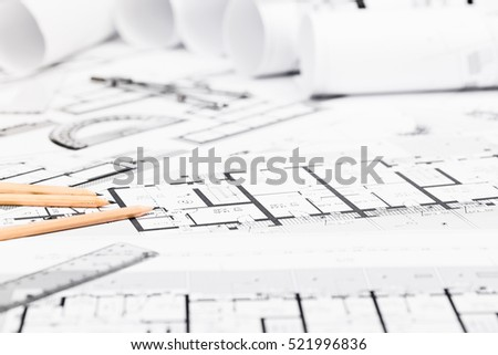 Construction plans drawing tools on blueprints stock photo royalty construction plans with drawing tools on blueprints architectural and engineering housing concept malvernweather Images