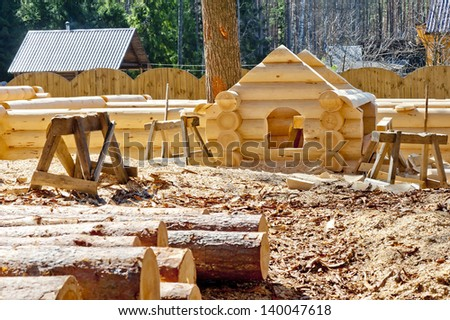 Construction plaschadka processing and assembly log cabins houses made of round timber with the bottom groove - stock photo