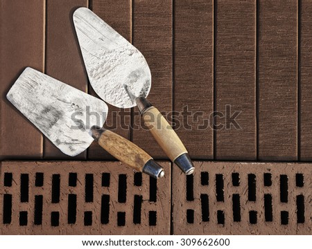 Construction's tools on brown clinker brick background. Brick masonry concept. Space for text.  - stock photo