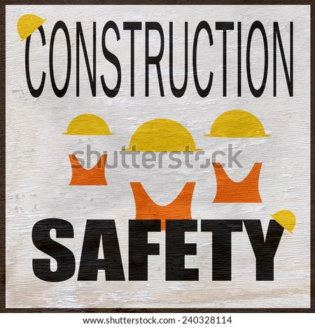 construction safety design with hard hats and vests on wood grain texture - stock photo